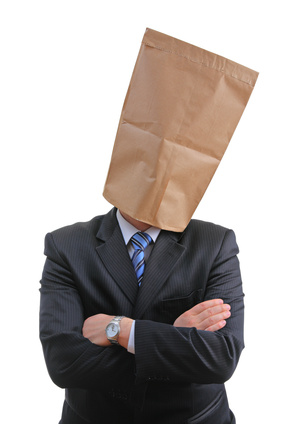 Introverted man with paper bag over head